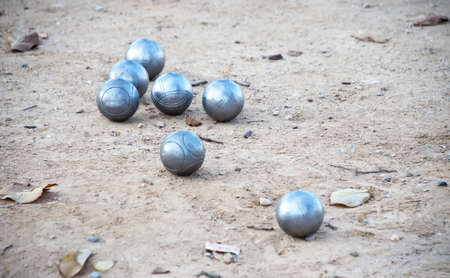bocce ball: Bocce balls in the field of land