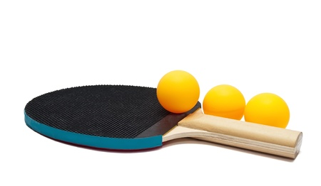 Table tennis racket and three balls  on white background  photo