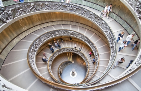 spiral stairway: ROME, ITALY-OCTOBER 17: Unidentified people down the spiral staircase of Vatican Museums in Rome October 17, Italy.  These stairs were designed by Giuseppe Momo in 1932