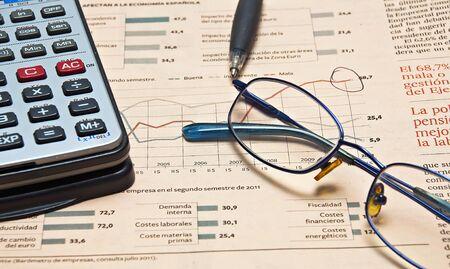 Newspaper and glasses Calculator  Stock Photo
