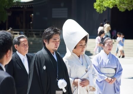 formality: TOKYO, JAPAN, JULY 10: Celebration of a typical wedding in Japan on July 10, 2011 in Tokyo, Japan.   The date that most weddings are held in November is the month because the 11 is a lucky number. The wedding is rapid, flow, protocol and little joy.