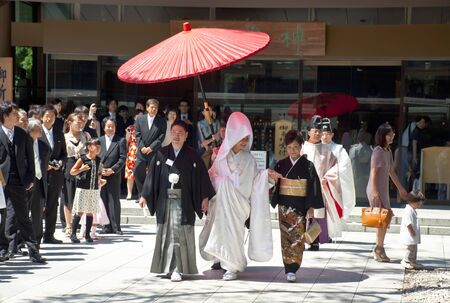 TOKYO, JAPAN, JULY 10: Celebration of a typical wedding in Japan on July 10, 2011 in Tokyo, Japan.   The date that most weddings are held in November is the month because the 11 is a lucky number. The wedding is rapid, flow, protocol and little joy.  Stock Photo - 11719673