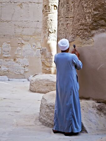 Working in the columns of the temple of Karnak, Egypt Stock Photo - 11958297