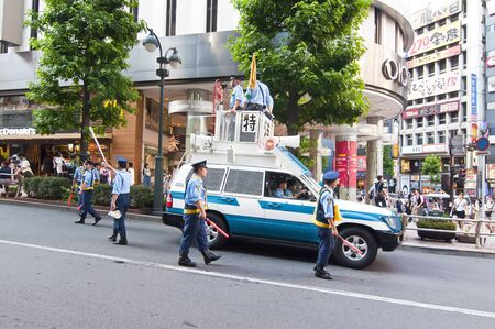 TOKYO, JAPAN - JULY 9: Japanese police group of unidentified Shibuya district on July 9, 2011 in Tokyo, Japan.  Japanese police has approximately 221,000 agents