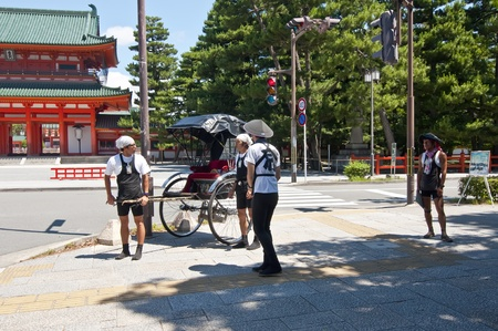 KYOTO, JAPAN, JULY 17: A group of rickshaw drivers unidentified  on July 17, 2011 in Kyoto, Japan. The word is of Japanese origin rickshaw and Means human-powered vehicle