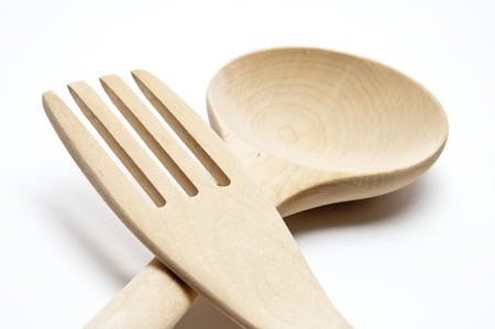 cooking ware: New wooden kitchen utensils on white background