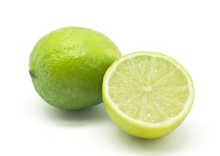 A whole lime and half a lime on white background Stock Photo