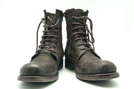 Brown leather boots on a white background photo