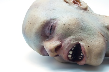 Recreation a severed human head on a white background photo