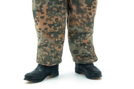 Legs German soldier with camouflage pants photo