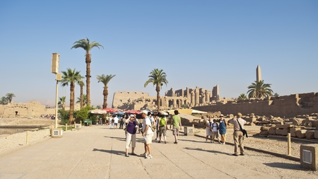 LUXOR, EGYPT-APRIL 27: Unidentified tourists visiting the temple of Karnak in Luxor on April 27, 2010 in Luxor, Egypt