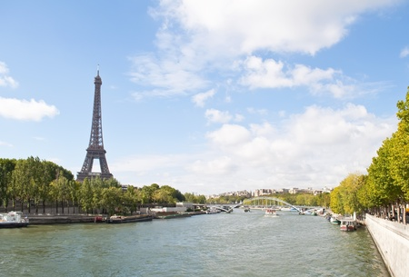 The Seine River passing by the Eiffel Tower in Paris, France photo