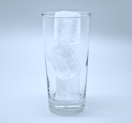 Empty glass with ice in blue photo