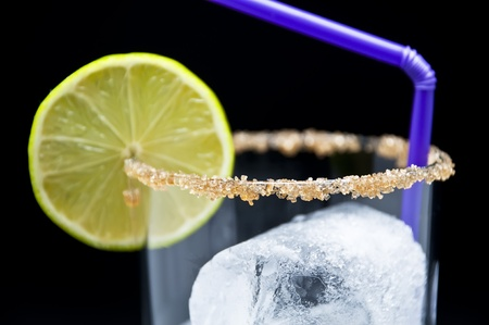 Prepared for a cocktail glass with lime and sugar photo