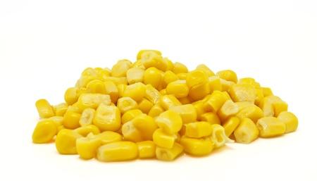 corn yellow: El ma�z pila en el fondo blanco Foto de archivo