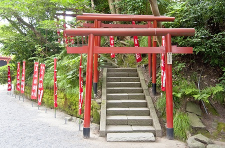 A Tory is a traditional Japanese bow is usually found at the entrance to Shinto shrines (Jinja), marking the border between the profane and the sacred space. They consist of two columns on which are supported by two parallel beams Stock Photo - 12890320