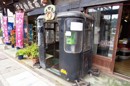 NIKKO, JAPAN, JULY 7: old phone booth on July 7, 2011 in Nikko, Japan.    The series of shrines and sacred places that are in Nikko, and spas (onsen) in the area, make the town a tourist and religious center visited. The set of temples and shrines of Nikk