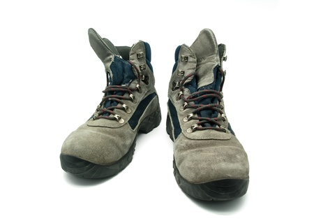 Mountain boot worn over white background photo