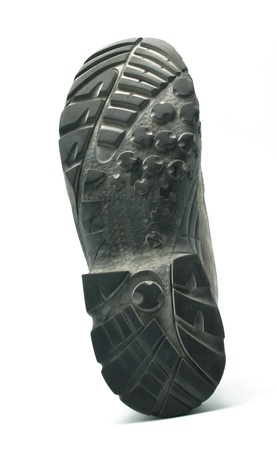 Soled boots upright on white background photo