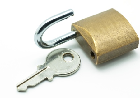 Open lock key on white background Stock Photo - 12890372