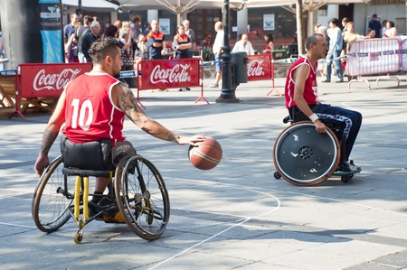 paraplegic: TOLEDO, SPAIN, OCTOBER 1: Some unidentified people playing a friendly game of wheelchair basketball, one of the activities in the Youth Week on October 1, 2011 in Toledo, Spain