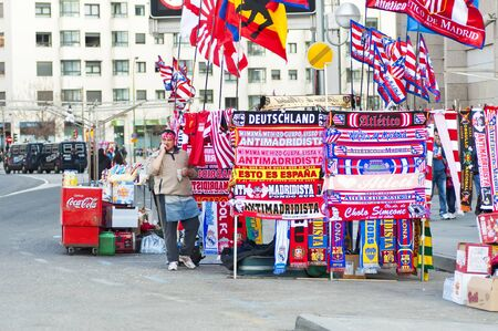 MADRID, SPAIN-MARCH 29: outside the Vicente Calderon soccer stadium to market T-shirts and scarves before the game vs. Atletico Madrid. Hannover on March 29, 2012 in Madrid, Spain. Atletico Madrid won 2-1. The party is for the Europa League