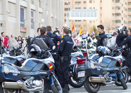 MADRID, SPAIN-MARCH 29: police outside the Vicente Calderon soccer stadium during the match Atletico Madrid vs. Hannover on March 29, 2012 in Madrid, Spain. Atletico Madrid won 2-1. The party is for the Europa League