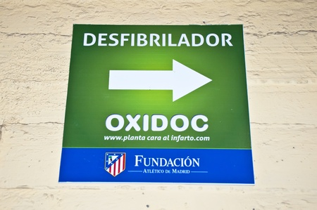 MADRID, SPAIN-MARCH 29: Poster defibrillator in the Vicente Calderon soccer stadium During's soccer game vs. Atletico Madrid. Hannover on March 29, 2012 in Madrid, Spain. Atletico Madrid won 2-1. The party is for the Europa League Stock Photo - 13022323