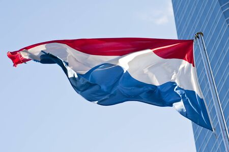Dutch flag waving in the sky photo