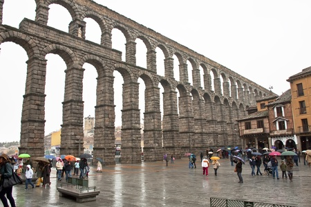 SEGOVIA, SPAIN - APRIL 7: Unidentified Tourists next to the Aqueduct of Segovia on April 7, 2012 in Segovia, Spain.  It is the work of Roman civil engineering major from Spain. The researchers placed between the second half of the century and the beginnin Stock Photo - 13096259