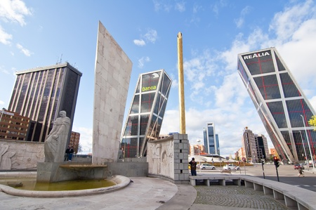 MADRID, SPAIN - APRIL 7: Plaza Castilla on April 7, 2012 in Madrid, Spain.  Located in the north of the city and is crossed by the Paseo de la Castellana. And in it are the Torres Kio, the Obelisk of the Fund and the monument to Jose Calvo Sotelo