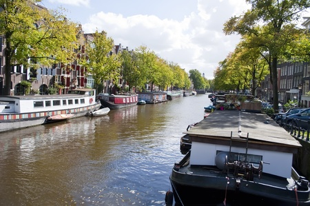 gabled house: AMSTERDAM, NETHERLANDS, SEPTEMBER 15: canal in Amsterdam on September 15, 2010 in Amsterdam, Netherlands.  Amsterdam is known as the Venice of the North for over 100 kilometers of canals. This part of the city has been included by UNESCO in the list of Wo