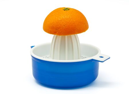 Manual Juicer  with oranges on white background photo