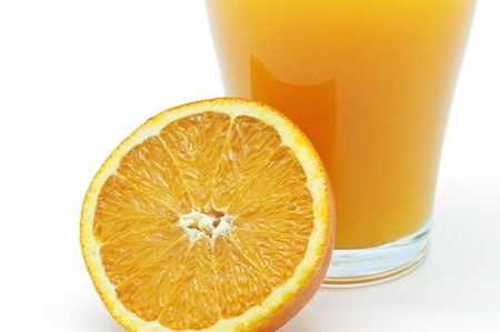 Orange juice in a glass with half orange photo