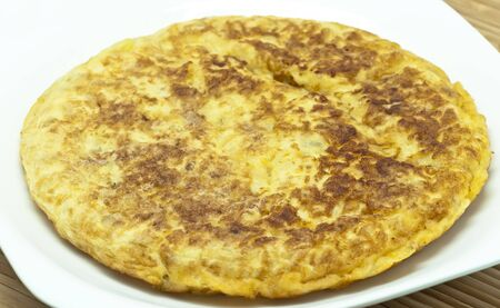 Spanish potato omelet on a white dish  photo