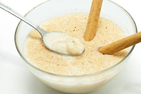 Savory Rice pudding with cinnamon sticks photo
