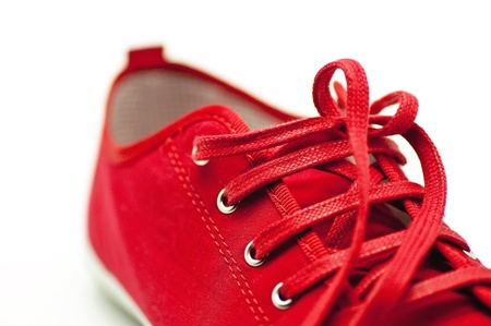 sports clothing: Red Shoes closeup on white background Stock Photo