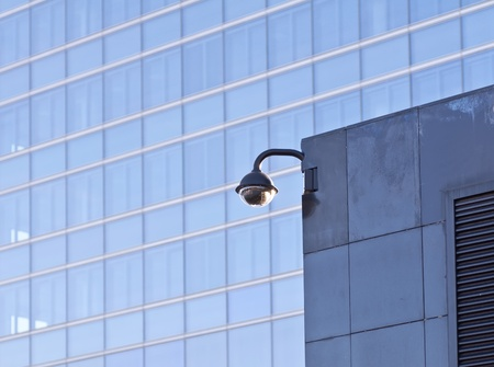 Security video camera Against modern building photo