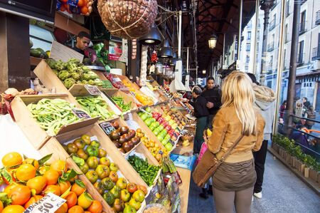 two floors: MADRID, SPAIN-OCTOBER 27: Unidentified people shopping in the famous market of San Miguel on October 27, 2011 in Madrid, Spain It retains its original iron structure of the early twentieth century. It has two floors and an area of ??1,200 square meters