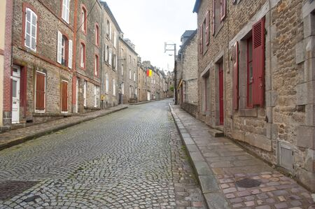 dinan: Typical cobblestone street in the city of Dinan, France Stock Photo
