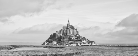 View of the famous Le Mont Saint Michel in Normandy, France. Black & white photography photo
