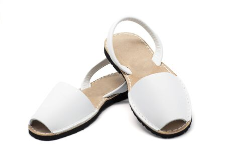 plain stitch: A pair of white sandals over white background