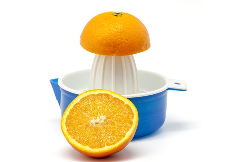 Manual Juicer  with oranges on white background Stock Photo - 14211742