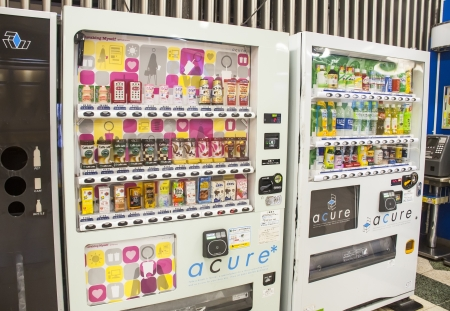 TOKYO, JAPAN - JULY 3: drinks vending machine of different brands on July 3, 2011 in Tokyo, Japan  They distribute beverages like coffee, tea and soft drinks.