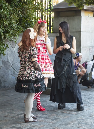 TOKYO, JAPAN - JULY 10: Unidentified people dressed in Harajuku district on July 10, 2011 in Tokyo, Japan.  It is known for being one of the most popular shopping venues in the city, while serving as a meeting point for young people who gather every Sunda Stock Photo - 14998387