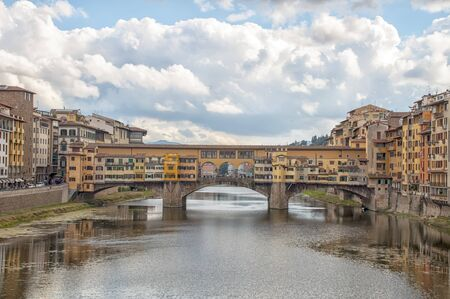 Ponte vecchio across arno river. Florence. Italy photo