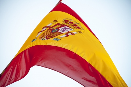 Spanish flag waving in the sky photo