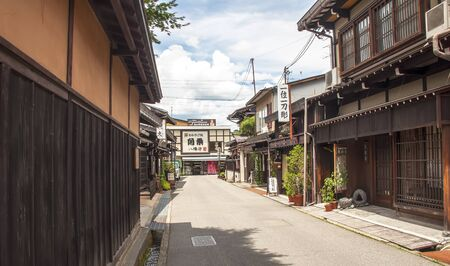 estimated: TAKAYAMA, JAPAN-JULY 12: One of the famous streets empty of Takayama on July 12,2011 in Takayama, Japan.  It has an estimated population of 99,497 inhabitants and is located between the mountains of the Japanese Alps