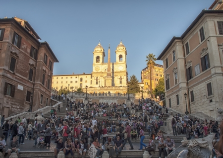 ROME, ITALY-OCTOBER 15: Unidentified tourists on the steps leading up to the church of Trinita dei Monti located in the Piazza di Spagna in Rome on October 19.2015, Italy.The Scalinata is the widest staircase in Europe.  Stock Photo - 15078878