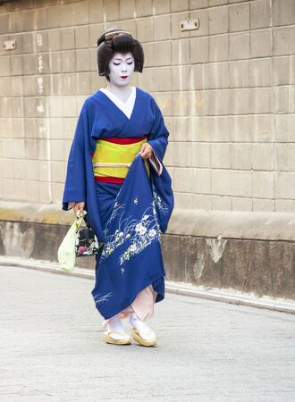 KYOTO, JAPAN, JULY 16: Unidentified geisha posing for photos in the Gion district on July 16, 2011 in Kyoto, Japan. In the 1920 had some 80,000 geisha in Japan, but today there are approximately 1,000. Stock Photo - 15132346